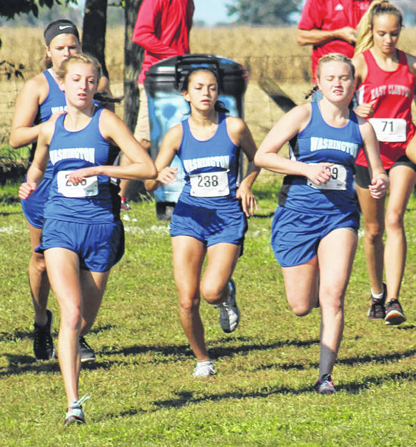 Washington High School girls at the start of the Cross the Creek meet Saturday. (l-r); in back, Shawna Conger, Cloe Copas, Mia Moats, Abby Tackage.