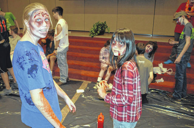 At the Laurel Oaks Fall Fest in Wilmington on Saturday, students get ready for the annual Zombie 5K Run/Fun Walk. In the foreground from left are Kelsey Inskeep and Noah Fukita, both of whom's home school is Washington C.H. High School. They and others are in the auditorium at the Laurel Oaks Career Campus. The event also included a trunk-or-treat, free hot dogs, pumpkin chucking, and health screenings administered by zombies.