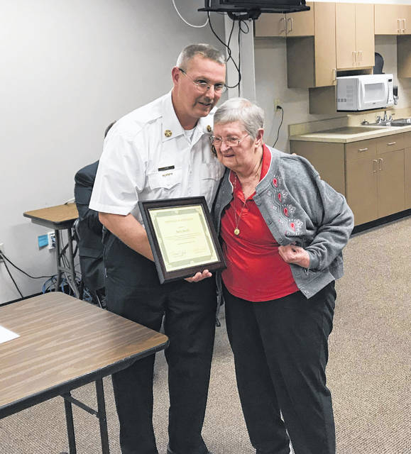 Washington Fire Chief Tim Downing presented Doris Smith with a certificate of appreciation Wednesday evening.