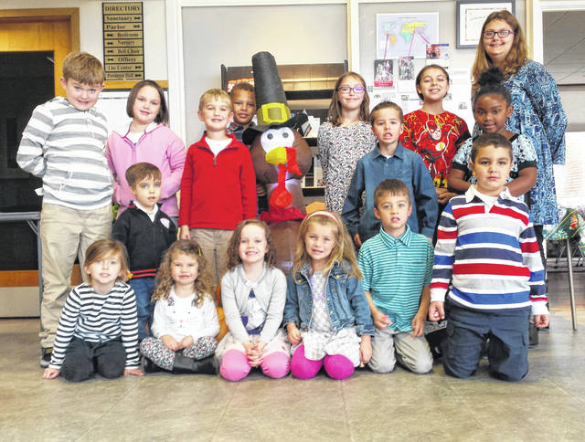 First Presbyterian Church is delivering Thanksgiving meals to home-bound Fayette County residents. The children of the church, in front: Lucy Abbott, Simon Mitchell, Gracie Armintrout, Hannah Rohr, Hannah Preston, Henry Marshall, Remington Butcher, and in back: Tommy Garrison, Kahlen Jones, Ethan Garrison, Matticks Hernandez, Taylor Booth, Kaylee, Simone Elkins and Christy Butcher.