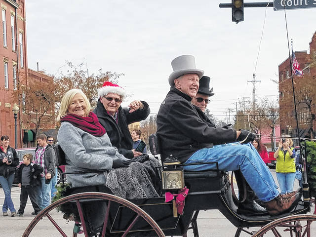The 2018 Christmas Parade was held on Sunday afternoon with residents from all over the county taking time to visit Washington Court House and watch the procession. Evelyn Pentzer, the retired Fayette County Clerk of Courts, and Jack DeWeese, a retiring county commissioner, were honored as co-grand marshals for the parade. The Fayette County Chamber of Commerce thanked local dentist Dr. John Jordan and his guest — John Rittenhouse — for taking time to drive the two honorees during the parade.