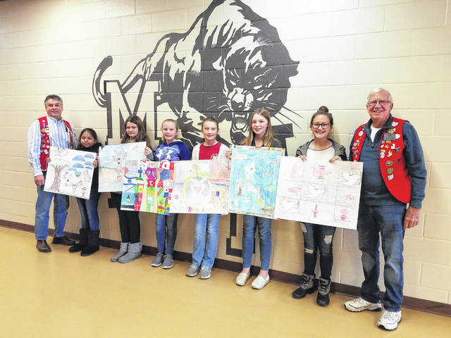 New Holland Lions Club President Marty Mace and Jeffersonville Lions Club President Gary Herdman visited Miami Trace Middle School to congratulate the six winners of the 2018 Peace Poster Contest. Pictured (L to R): Mace, New Holland first place winner Asucel Cruz, New Holland second place winner Audrey White, New Holland third place winner Carley Payton, Jeffersonville first place winner Lily Waddle, Jeffersonville second place winner Emma Trimble, Jeffersonville third place winner Sophia Schirm and Herdman.