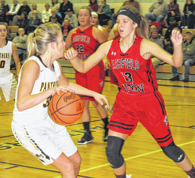 Miami Trace senior Cassidy Lovett, left, is guarded by Fairfield Union junior Evie Wolshire during a non-conference game in the Panther Pit at Miami Trace High School Tuesday, Nov. 27, 2018.