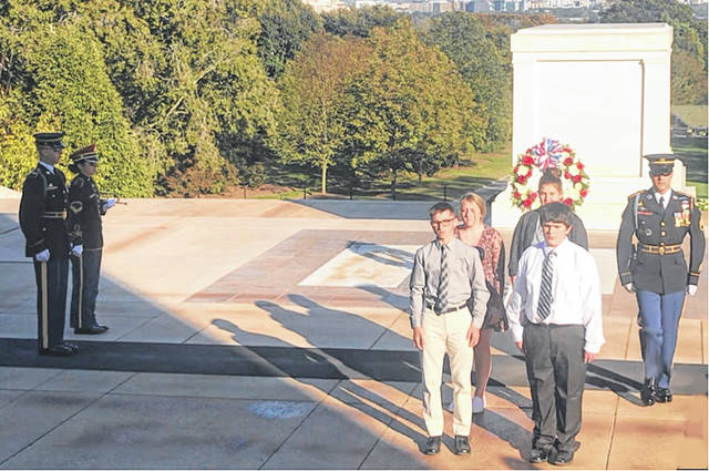 On Oct. 23, four Miami Trace Middle School students took part in a special wreath-laying ceremony to honor U.S. soldiers at the Tomb of the Unknown Soldier at Arlington National Cemetery in Arlington, Va. The four students, Madison Williams, Alayna Baughn, Aiden Johnson and Jesse Bryant, are pictured here with guards at the tomb.