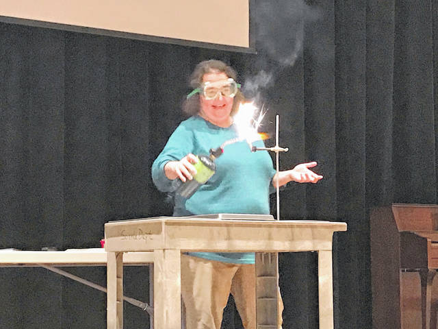Washington High School teacher Briana Richardson ignites a classroom-made sparkler to demonstrate how the properties of different elements burn uniquely. This demonstration was part of the LIONS IGNITE 1.0.
