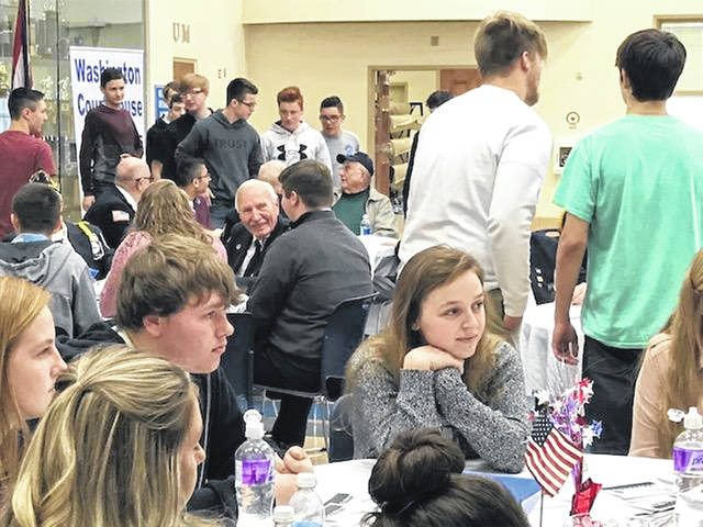 Washington High School (WHS) invites all veterans and current service members to join them for a free meal this Friday. Pictured are students talking with and thanking veterans at last year's lunch.