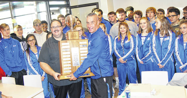 Nick Epifano, owner and operator of McDonald's of Fayette County and Jamestown, at left, presents the traveling trophy to Washington Blue Lion head coach Chuck Williamson Saturday, Nov. 3, 2018. Epifano sponsors the trophy, which goes to the winning team of the Miami Trace vs. Washington football rivalry game. Washington won this year's match-up, 34-7.