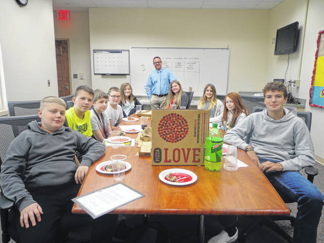 "Donatos recently provided pizza to these students at Washington Middle School as they celebrated ""Pizza with the Principals."" This is in appreciation for their selection as Students of the Month for October. They are chosen by their teachers because of the outstanding example they set for their peers in such areas as academic effort, good work ethic, kindness to others, and service to their school. Pictured from left: Adrian Jones, Seann Roper, Nicholas Lutz, Connor Schoenfeld, Hannah Barrett, Mr. Montgomery (Assistant Principal), Macy Mahorney, Margo Funderburg, Hannah Smith, and Noah Hicks."