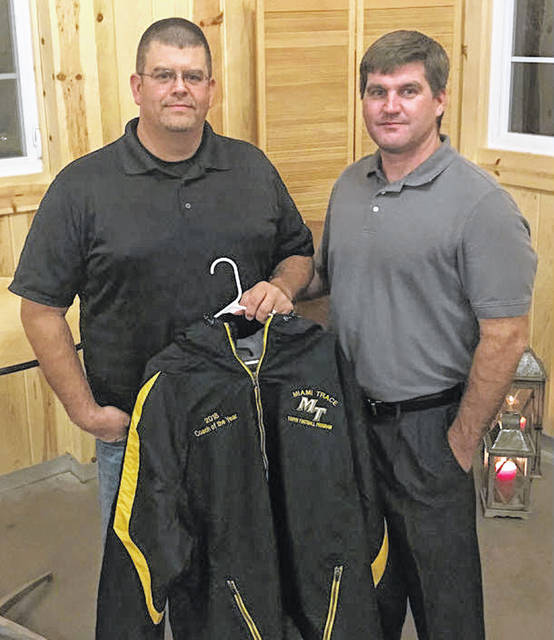 Brian White, left, head coach of the JV White team, was named Coach of the Year Saturday, Nov. 10 at the annual Miami Trace Youth Football Program coaches banquet. The banquet was catered by Matt Pettit (Streetside 62) and was held at the elegant Flora and Field facility near Deer Creek State Park. White is pictured with Rob Guthrie, president of the MTYFP.