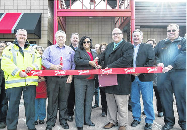 The Frisch's Big Boy leadership team, along with Washington Court House city officials, celebrated the opening of the remodeled restaurant at 1815 Columbus Ave. this week. The following participated in the ribbon cutting, left to right: Tim Downing-Fire Chief of Washington Court House Fire Department, Eric Miller-Frisch's Area Coach, Bob Ritter- Frisch's EVP of Operations, Cheryl White-Frisch's Region Coach, Joseph Denen-City Manager of Washington Court House, Jason Vaughn-Frisch's CEO, and Tom Youtz- Fire Chief of Washington Court House Fire Department.