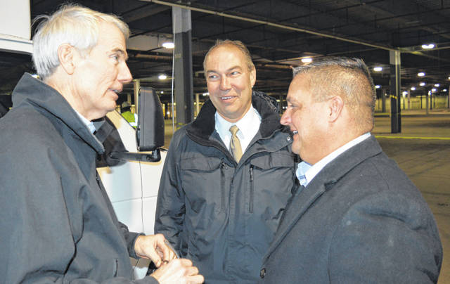 U.S. Sen. Rob Portman (R-Ohio), left, chats with State Sen. Bob Peterson (R-Washington Court House), center, and State Rep. Shane Wilkin (R-Hillsboro), right, inside Building F at the Wilmington Air Park.