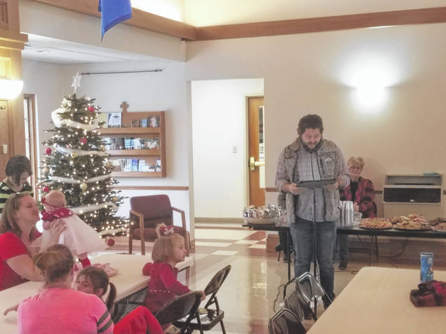 Pregnancy Center on South Fayette Street held its annual Christmas party on Wednesday afternoon at the St. Colman Catholic Church in Washington Court House. Caleb Baumgardner, youth minister at Crossroads Christian Church, read the story of the birth of Jesus Christ.