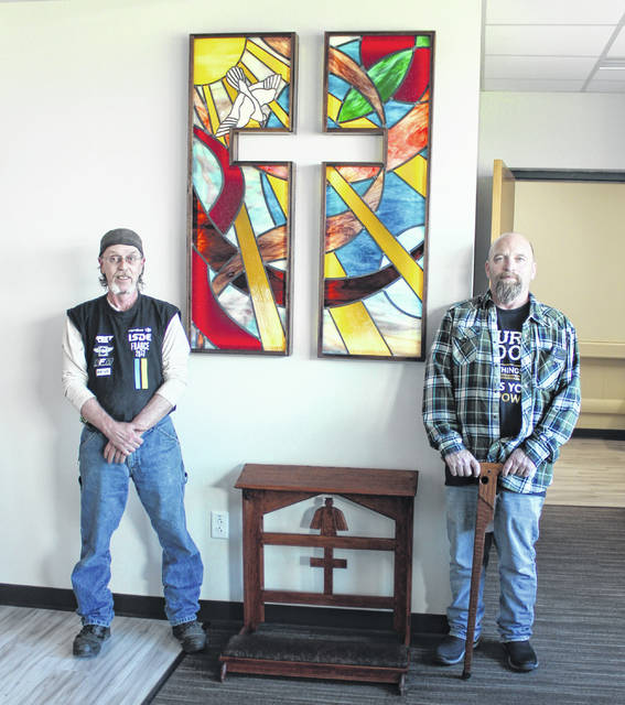 Stained glass artist Bernie Evans and kneeling prayer alter craftsman Ed Wolfe.