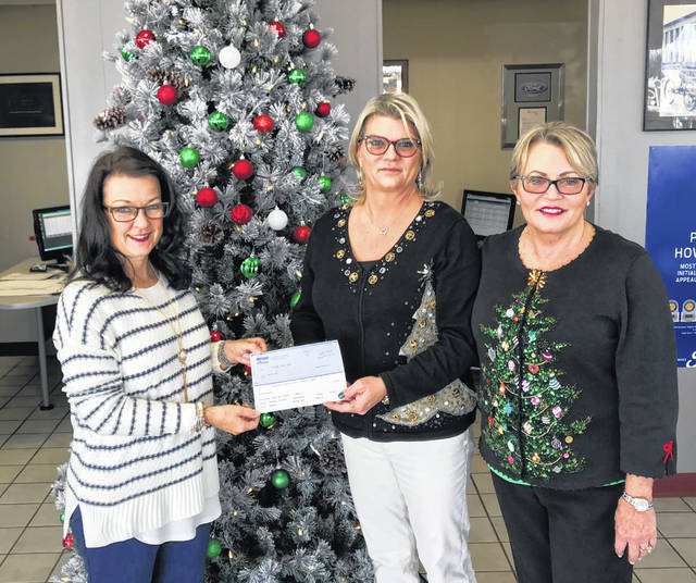 Missy Meacham (middle) and Connie Beford (right), owners of Beford Ford, present a check to Debbie Bryant, executive director of United Way of Fayette County, in order to help underprivileged children this holiday season.
