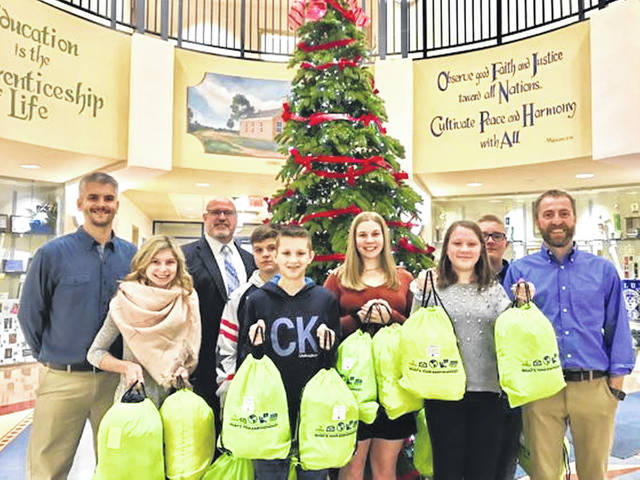 Representatives from the Domtar Paper Company and its Earth Choice Program recently visited Washington Middle School, bringing with them 65 brand-new coats.