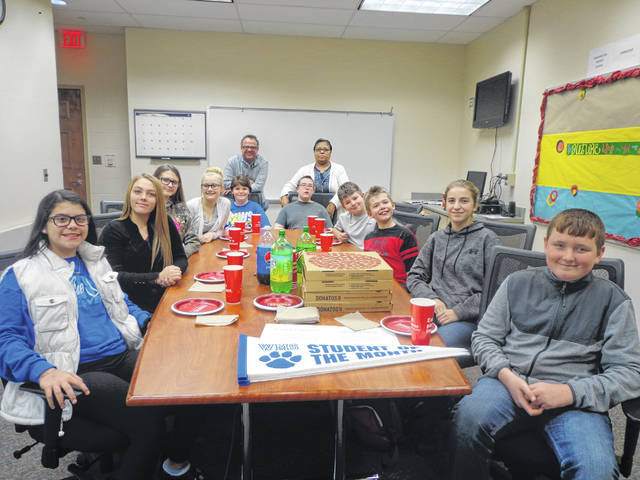 "Donatos recently provided pizza to these students at Washington Middle School as they celebrated ""Pizza with the Principals."" This is in appreciation for their selection as Students of the Month for December. They are chosen by their teachers because of the outstanding example they set for their peers in such areas as academic effort, good work ethic, kindness to others, and service to their school. Pictured (L to R): Isabel Fernandez, Marissa McNamee, Amber Whiteside, Jaliza Worth, Ashley Wagner, Mr. Montgomery, Asst. Principal, Mrs. Rickman, Paraprofessional, Tyler Roland, Austin Coy, Dylan Coy, Bruklynn Swisher and Jacob Speakman. Absent from picture: Faith Adams."