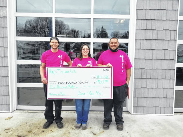 Hay's Auto & Tire made a donation. From left to right, Ken Frey, and Jen and Brad Hay.