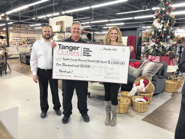 Pictured left to right: Andy Gibson, Tanger Outlets Jeffersonville Assistant General Manager, Rodney List, Fayette County Memorial Hospital EMS Director, and Kristen Hauer, Tanger Outlets Jeffersonville General Manager.