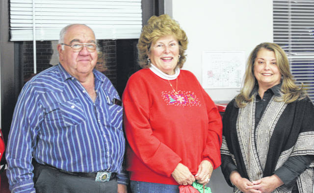 Caryl Wagner Bookman (center) was honored by the FCBDD at the board's December meeting. She is pictured with Larry Mayer, president, and Deb Buccilla, superintendent.