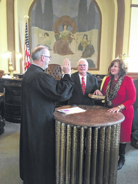 Fayette County Common Pleas Court Judge Steven Beathard swore in Jim Garland Friday to replace Jack DeWeese as the next Fayette County Commissioner. Garland is pictured with his wife Melissa of 43 years.