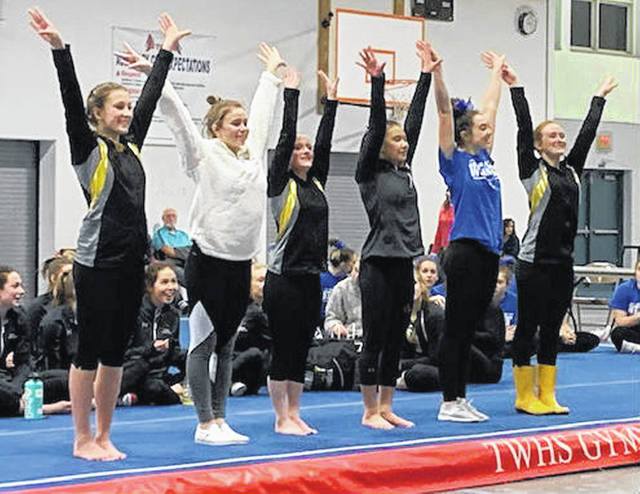 Lizzy Valentine of Greeneview stands in fifth place (second from right) for balance beam Tuesday, Dec. 11, 2018 at Thomas Worthington High School.