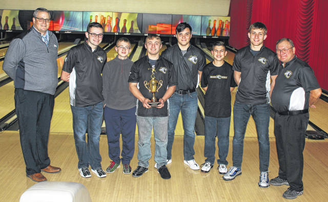 The Miami Trace bowling team recently won the Pioneer Baker Invitational, held in Plain City and hosted by Jonathan Alder High School. Above are the team members who took part, as well as Miami Trace High School Athletic Director Aaron Hammond and head coach Ron Amore Sr. (l-r); Hammond, Luke Everhart, Chris Evans, Jay Caudill, Mike West, Connor Collins, Andrew Amore and Amore Sr. Not pictured: James Kysor.