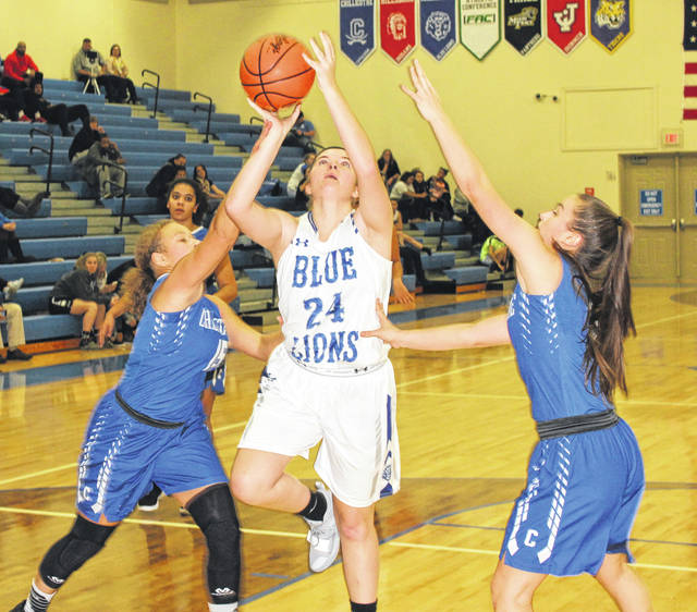 Washington senior Maddy Jenkins (24) puts up a shot between two Chillicothe defenders during a Frontier Athletic Conference game Wednesday, Dec. 5, 2018. Jenkins scored 10 points and had seven rebounds help Washington to the win.