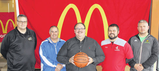 Athletic directors from the four participating schools met with McDonald's of Fayette County and Jamestown owner and operator Nick Epifano (center) on Thursday to finalize plans for the 2018 McDonald's Holiday Tournament. (l-r); Aaron Hammond, Miami Trace; Mark Rinehart, Greeneview; Epifano; Jimmy Wolverton, London and Matt Mason, Madison Plains.