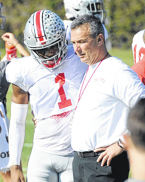 Urban Meyer talks with receiver Johnny Dixon during an Ohio State Rose Bowl practice.