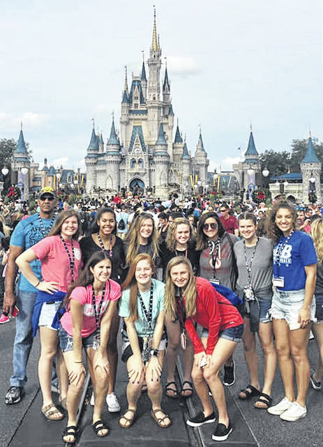 The Washington Lady Blue Lion varsity basketball team is currently on a trip to Florida, playing three games in three days and taking in some of the sights and having fun. The team visited Disney World's Magic Kingdom, Thursday, Dec. 27, 2018. In the background is the iconic Cinderella Castle. (front, l-r); Kassidy Hines, Tabby Woods, Bre Taylor; (back, l-r); assistant coach Mychal Turner, Maddy Jenkins, Rayana Burns, Halli Wall, Abby Tackage, head coach Samantha Leach, Shawna Conger and Hannah Haithcock.