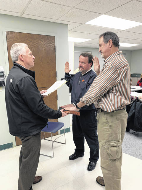 Fayette County Probate/Juvenile Court Judge David Bender swears in Mitchell Kirby and Mark Heiny at the Fayette County Board of DD organizational meeting.