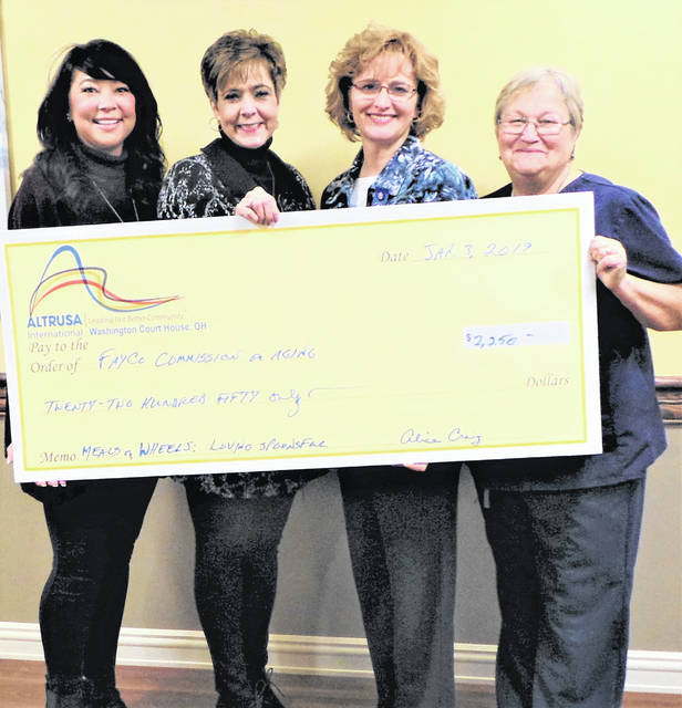 "Altrusa International of Washington C.H., Inc., gave away the proceeds from its eighth-annual Loving Spoonsful tasting luncheon at the start of its first business meeting of 2019. The first presentation of a check for $2,250 went to the Fayette County Commission on Aging's ""Meals on Wheels"" senior nutrition program. Representing the COA were Ginger Munro and Cheryl Stockwell, who were joined for the photo by Altrusans Julie Hidy, co-chair of the Loving Spoonsful committee, and President Elaine Crutcher. Stockwell announced that the influx of funds was well-timed, as not only had Meals on Wheels just run out of money, but also the new amount allotted had again been decreased."