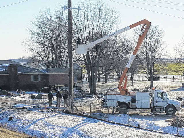On Friday, Dayton, Power & Light workers continued their efforts to fix the downed poles in the county from last weekend's snow and ice storm. Many trucks and crews helped with a power line that stretched across State Route 41 near the U.S. 35 bypass that continued to keep the road closed for the last week.