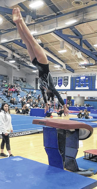 Alyssa Butler, Miami Trace freshman, executes a handspring over the vault table.