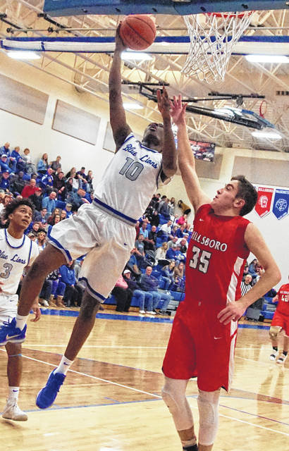 Washington senior Blaise Tayese takes the ball to the basket for two of his game-high 16 points in a 51-39 Frontier Athletic Conference victory over Hillsboro Friday, Jan. 11, 2019 at Washington High School. Pictured for Hillsboro is sophomore Brad Miller and for Washington, at left, is senior Evan Upthegrove.