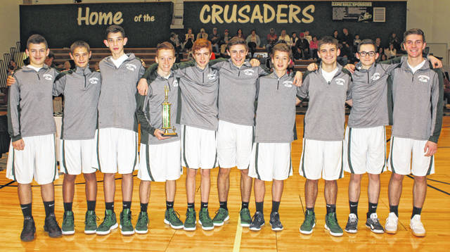 The Fayette Christian School Crusaders on the floor after winning the 2nd Annual McDonald's Invitational Saturday, Jan. 26, 2019. (l-r); Justin Wines, Brady Bumpus, Drew Pontious, Spencer Hanusik, Christopher Tooill, Nicholas Epifano, Nate Crichton, Michael Miller, Xander Ivey and Lane Hufford.