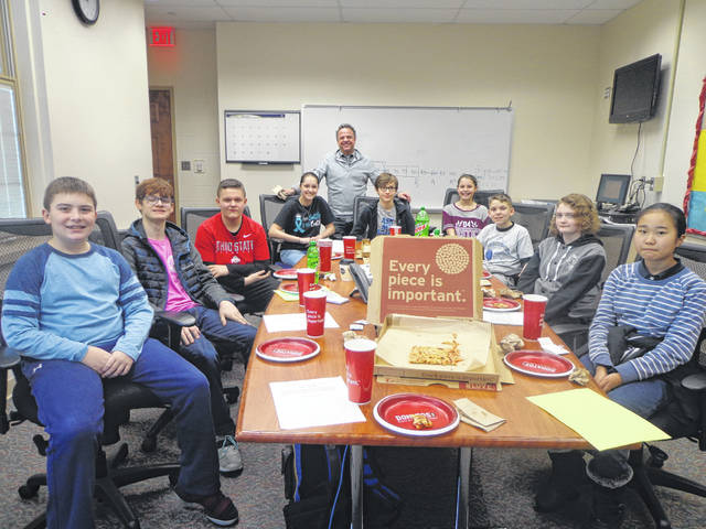 "Donatos recently provided pizza to these students at Washington Middle School as they celebrated ""Pizza with the Principals."" This is in appreciation for their selection as Students of the Month for January. They are chosen by their teachers because of the outstanding example they set for their peers in such areas as academic effort, good work ethic, kindness to others and service to their school. Pictured (L to R): Logan Clevenger, Braden Johnson, Rylan Ellison, Audrey Lotz, (Troy Montgomery, Asst. Principal) Jayden Parrish, Kenzie Grossenbacher, Jason Wagner, Bryanna Teeters and Yukino Nagakura."