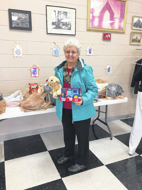 Diana Febo is pictured with the annual toy drive, which benefits The Well. Fayette County Retired Teachers also contributed over 4,000 volunteer hours this year in educational and community projects.