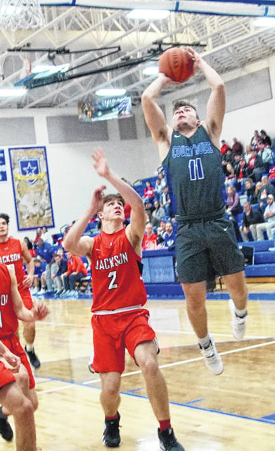 Washington Blue Lion junior Garitt Leisure sets for the pull-up jumper during a Frontier Athletic Conference game against Jackson at Washington High School Friday, Jan. 25, 2019. Pictured for Jackson is sophomore Treylan Davis (2).