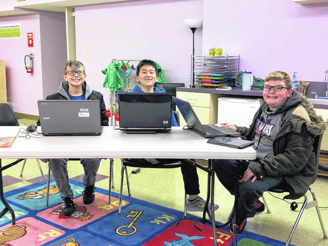 The Carnegie Public Library is continuing a weekly code club this month where kids will learn computer programming skills. Pictured (L to R): Jon Rader, Kentaro Yamazaki, and Slade Blakeley.