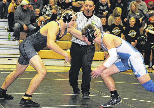 Miami Trace's James Munro (left) faces off against Washington's Jay Fettig during a Frontier Athletic Conference dual meet Thursday, Jan. 17, 2019 in the Panther Pit at Miami Trace High School.