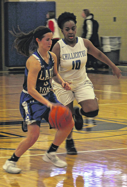 Washington senior Kassidy Hines brings the ball upcourt, guarded by Chillicothe's Emma Barnes during a Frontier Athletic Conference game at CHS Wednesday, Jan. 16, 2019.
