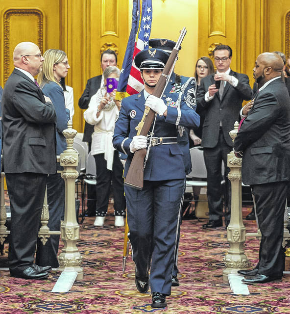 Color Guard enters the Senate Chamber for the opening ceremony.