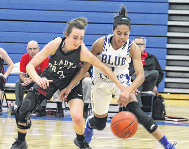 Washington junior Rayana Burns, at right, takes the ball away from Logan Elm junior Abby Hatter during a non-conference game at Washington High School Wednesday, Jan. 9, 2019. Burns was the game's leading scorer with 17 points.