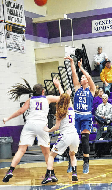 Washington junior Shawna Conger puts up a shot over Unioto's Jacie Fisher (21) and Hallie Pinkerton (5) during a non-conference game at UHS Saturday, Jan. 5, 2019.