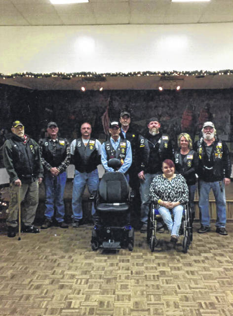 On Dec. 14 the American Legion Post 25 Riders met with Carrie Mason, the granddaughter of the late PFC Raymond Perkins, a WWII veteran who served in the army and was a Purple Heart recipient. Carrie has a rare brittle bone disease requiring her to be wheelchair dependent. Carrie only had a manual wheelchair, making it very difficult to enjoy certain circumstances of everyday living. Fortunate for the Legion Riders, an electric wheelchair was donated by Cheri Mikol and Mike Stritenberger, the children of the late James Stritenberger, who was also a WWII veteran who served in the Air Force.