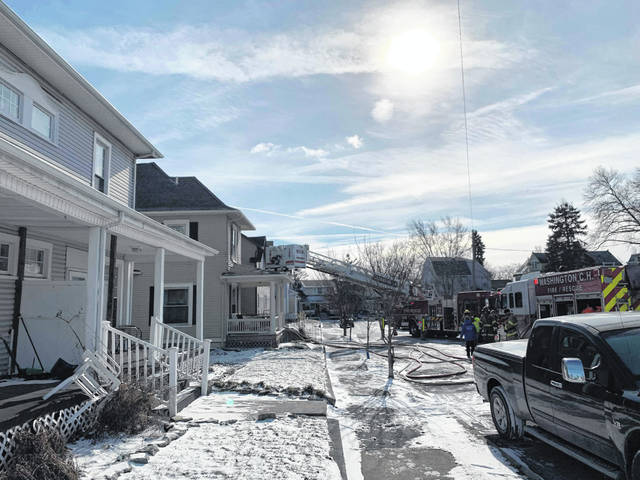 Firefighters responded to 120 Forest St. Thursday morning and extinguished a house fire, saving two dogs in the process.