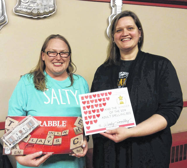 Carnegie Public Library hosted its first ever Adult Spelling Bee on Friday evening at Two Scoops of Sugar. Among other words, the brave contestants tackled quixotic, raconteur, onomatopoeia, and Buena Vista. Winner Wendy Smalley took home a Scrabble Crossword Game and honorary certificate. Smalley (left) is pictured with Carnegie Public Library Director Sarah Nichols.
