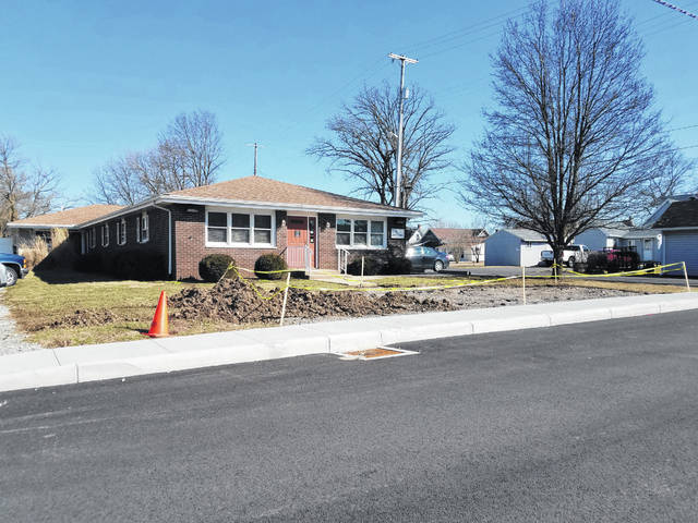Following the completion of a sidewalk in front of the building, Ohio's Hospice of Fayette County started replacing the asphalt that made up its old parking lot. Sod will soon be put down in the front of the building after the dirt settles.