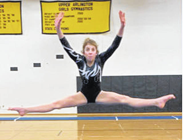 Miami Trace freshman Alexis Gardner exeuctes a straddle jump during her floor exercise routine.